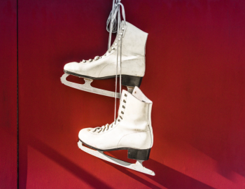 figure skates hanging on door