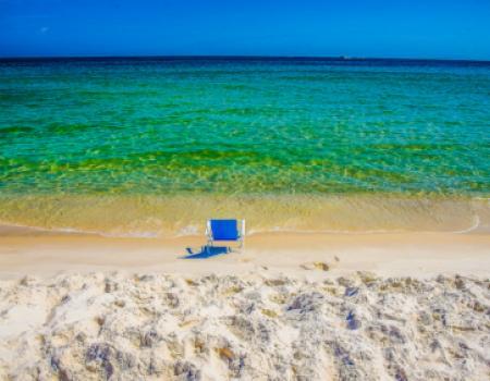orange beach alabama, blue beach chair in front of waves orange beach