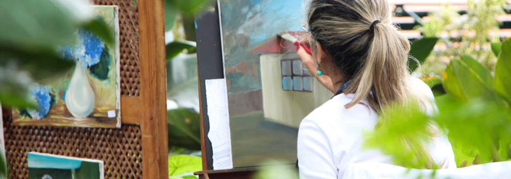 artist painting outdoors at an art festival